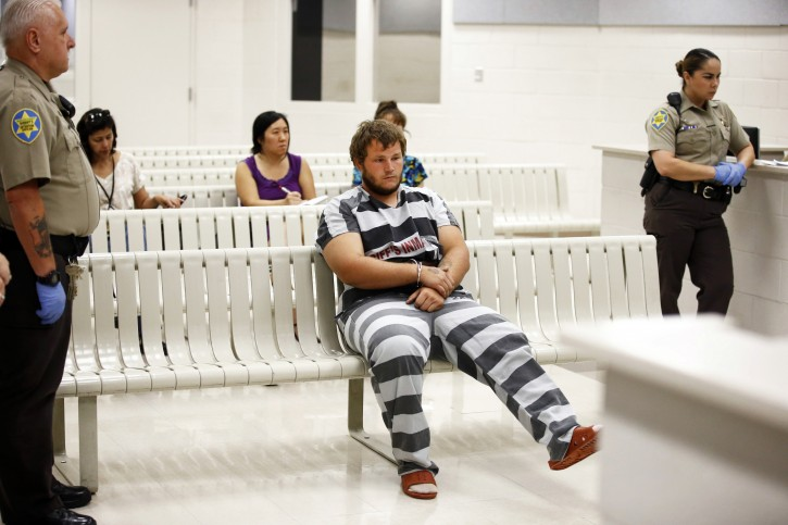 Leslie Allen Merritt Jr., waits to make his initial appearance before a judge at the Maricopa County Sheriff's Office on Saturday, Sept. 19, 2015, in Phoenix. The landscaper is the suspect in a series of Phoenix freeway shootings and was arrested Friday after trying to sell a gun at a pawn shop.  (Rob Schumacher/The Arizona Republic via AP, Pool)