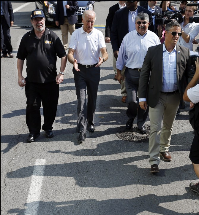Vice President Joe Biden, center, walks with United Steelworkers President Leo Gerard, left, and AFL-CIO President Rich Trumka as he joins joins in the annual Labor Day parade on Monday, Sept. 7, 2015, in Pittsburgh. (AP Photo/Keith Srakocic)
