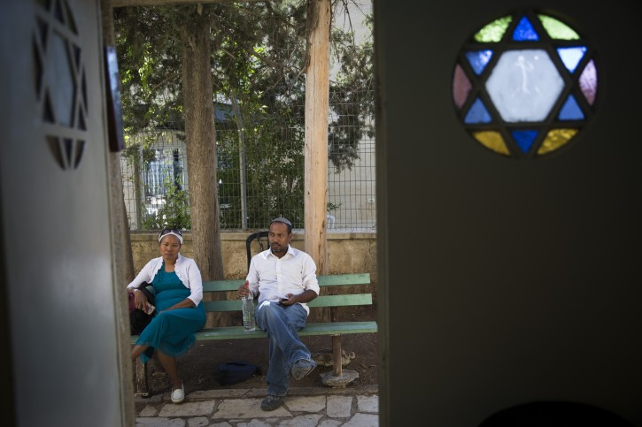 Members of the Bnei Menashe seen before the funeral ceremony for Rabbi Eliyahu Avichail, at the Ohel Avshalom Synagogue in Jerusalem on September 17, 2015. Eliyashiv was the rabbi of the synagogue and was a leader of the Aliya (immigration) and absoption of the Bnei Menashe Jews from India to Israel. Photo by Hadas Parush/Flash90