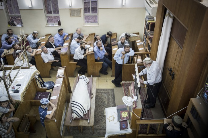 Members of the Bnei Menashe seen at the funeral ceremony for Rabbi Eliyahu Avichail at the Ohel Avshalom Synagogue in Jerusalem on September 17, 2015. Eliyashiv was the rabbi of the synagogue and was a leader of the Aliya (immigration) and absoption of the Bnei Menashe Jews from India to Israel. Photo by Hadas Parush/Flash90