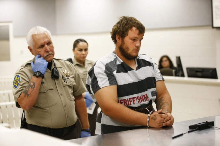 Leslie Allen Merritt Jr., makes his initial appearance before a judge at the Maricopa County Sheriff's Office on Saturday, Sept. 19, 2015, in Phoenix. The landscaper is the suspect in a series of Phoenix freeway shootings and was arrested Friday after trying to sell a gun at a pawn shop. (Rob Schumacher/The Arizona Republic via AP, Pool)