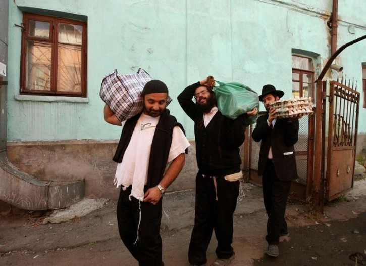 FILE - Ultra orthodox Jews carry food supply for the Jewish holiday of Rosh Hashana near the tomb of Rabbi Nachman of Breslov in the Ukrainian city of Uman. Reuters