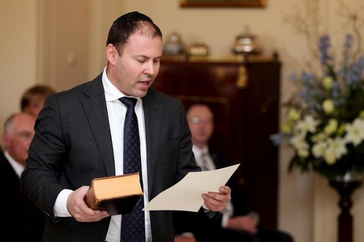 Australia's Minister for Resources, Energy and Northern Australia Josh Frydenberg participates in a swearing-in ceremony at Government House in Canberra, Australia, September 21, 2015. Reuters