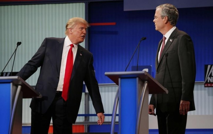 FILE - Republican 2016 U.S. presidential candidate businessman Donald Trump (L) talks with fellow candidate and former Governor of Florida Jeb Bush during a commercial break at the first official Republican presidential candidates debate of the 2016 U.S. presidential campaign in Cleveland, Ohio, August 6, 2015. REUTERS/Brian Snyder