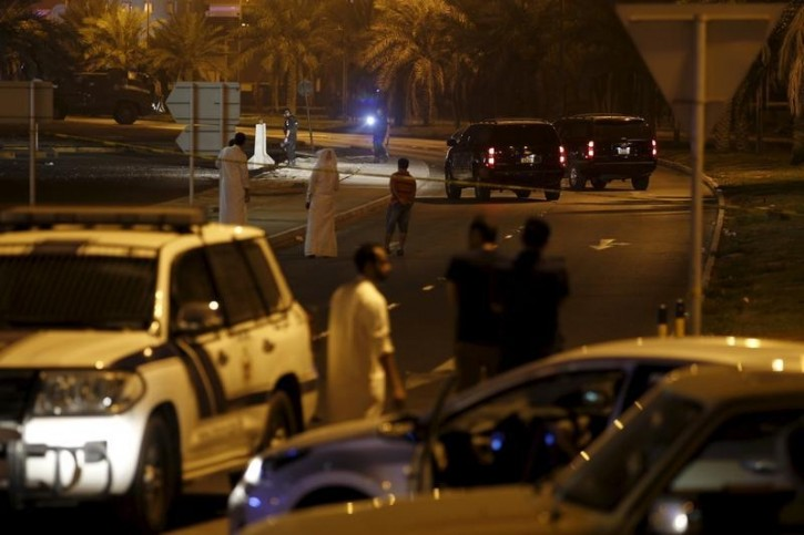 FILE - Policemen and EOD officials are seen at the bomb blast site where one police officer was killed late Friday evening in Budaiya west of Manama, Bahrain, August 28, 2015. Reuters
