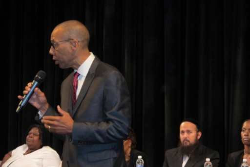 FILE - In this Aug. 13, 2015 file photo, former New York City Schools Chancellor Dennis Walcott addresses a community meeting in Suffern, N.Y., after being appointed monitor in the East Ramapo school district. (AP Photo/Jim Fitzgerald, File)