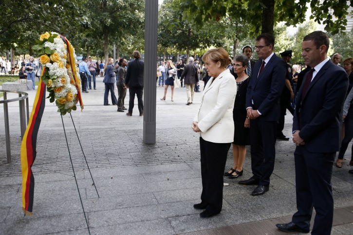 New York – Police Present Flag To German Chancellor At 9/11 Memorial