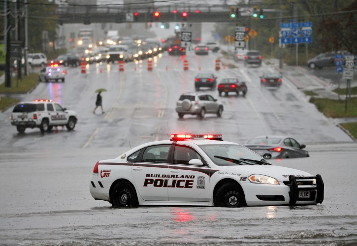 A police vehicle blocks a flooded road on Wednesday, Sept. 30, 2015, in Guilderland, N.Y. The National Weather Service has issued flood watches for much of the eastern half of upstate New York as a storm dumps more than two inches of rain across the region. (AP Photo/Mike Groll)