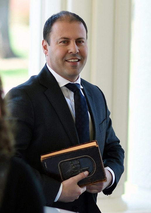 Australian Minister for Energy and Resources designate Josh Frydenberg (R) arrives for a swearing-in ceremony at Government House in Canberra, Australia, 21 September 2015. EPA