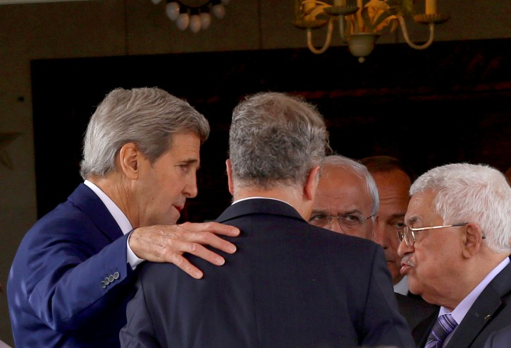 U.S. Secretary of State John Kerry, left, speaks with Palestinian President Mahmoud Abbas, right, after their meeting at Abbas' residence in Amman, Jordan, Saturday, Oct. 24, 2015. AP