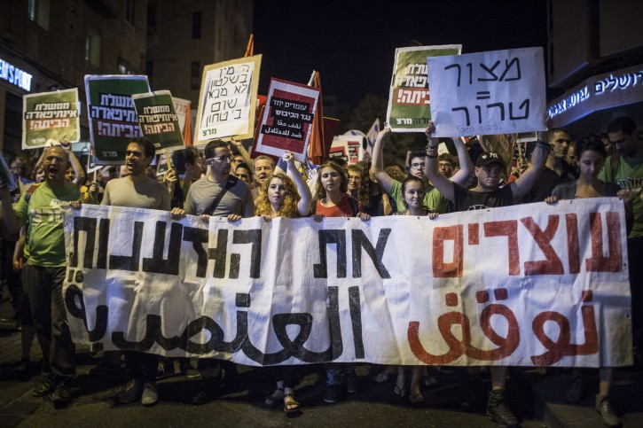 Thousands attend a demonstraion of Peace organizations composed of both Palestinian and Israeli left-wing activists as they march in central Jerusalem demanding a return to negotiations and a solution to the Israeli-Palestinian conflict, on October 17, 2015, following a wave of terror attacks and clashes in Israel and the West Bank. Photo by Hadas Parush/Flash90