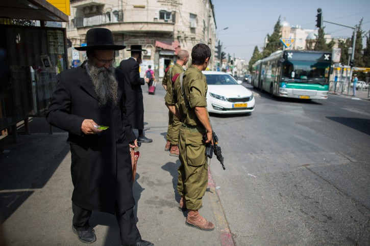 Israeli soldiers guard at a bus station in the Ultra orthodox neighborhood of Mea Shearim, Jerusalem, October 19, 2015. Photo by Yonatan Sindel/Flash90