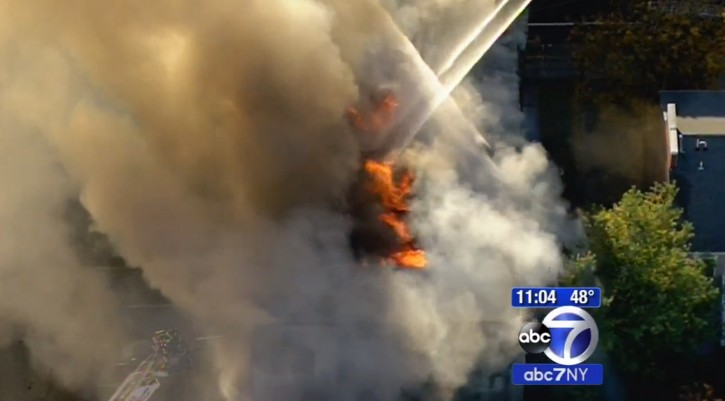 In this frame from video provided by WABC-TV, smoke and flames rise Friday, Oct. 23, 2015, at the Poile Zedek, a synagogue in New Brunswick, N.J. According to the congregation's website, the building was placed on the National Register of Historic Places in 1995. (WABC-TV via AP)