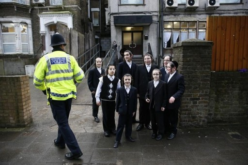 FILE - A police officer patrols in a Jewish neighbourhood in north London, January 17, 2015. REUTERS/Stefan Wermuth