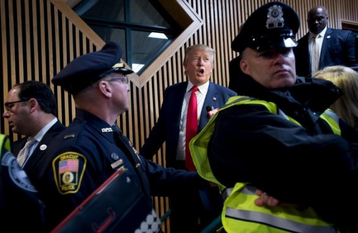 FILE - U.S. Republican presidential candidate Donald Trump leaves the stage surrounded by security after addressing the crowd at a campaign rally in Tynsboro, Massachusetts,  October 16, 2015.   REUTERS/Gretchen Ertl