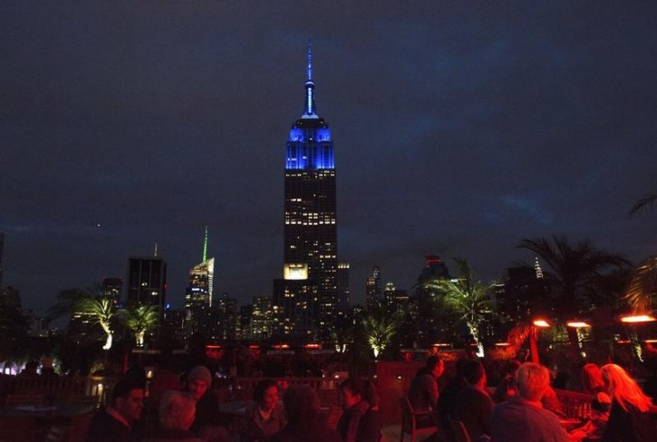 The Empire State Building is illuminated by blue lights to commemorate the 70th anniversary of the United Nations in the Manhattan borough of New York City, October 24, 2015. REUTERS/Stephanie Keith