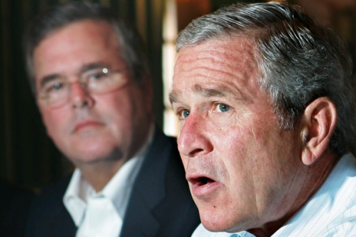 File: Former President George W. Bush (R) and his brother Jeb Bush, in Miami July 31, 2006. (Credit: Reuters/Jim Young)