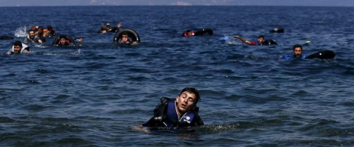 A refugee appears exhausted while swimming towards the shore after a dinghy carrying Syrian and Afghan refugees deflated about 100 meters before reaching the Greek island of Lesbos. (Alkis Konstantinidis/Reuters)
