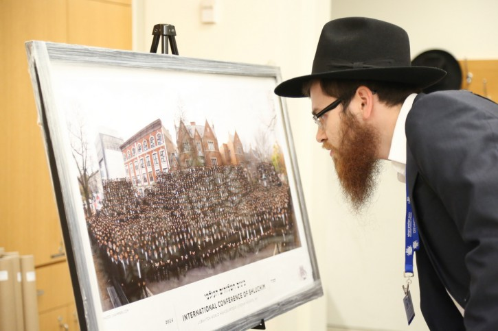 A Chabad-Lubavitch rabbi looks at the group photo of last year's conference at the International Conference of Chabad-Lubavitch Emissaries on November 6, 2015. The rabbi is among 5,200 rabbis and guests from around the world in New York for the conference, an annual event aimed at reviving Jewish awareness and practice around the world. This year's conference carries an added significance as Jewish communities worldwide celebrate the Biblical year of Hakhel, a time to promote Jewish unity and learning.