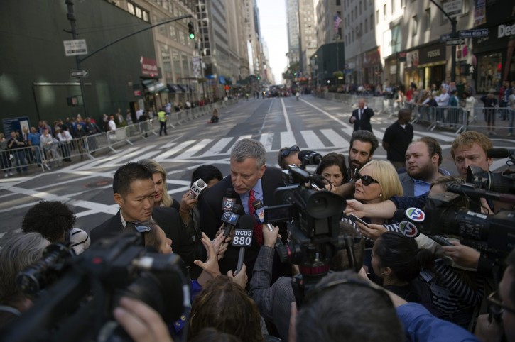 FILE- Mayor Bill de Blasio Holds Media Availability and Marches in Columbus Day Parade. Fifth Avenue, Manhattan. Sunday, October 12, 2015. Credit: Ed Reed/Mayoral Photography Office.