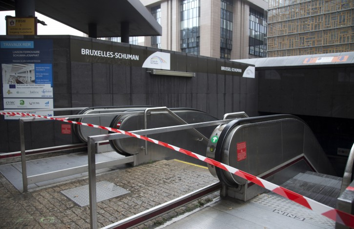 Police tape blocks the entrance of a metro station in Brussels on Saturday, Nov. 21, 2015. Belgium raised its security level to the highest degree on Saturday as the manhunt continues for extremist Salah Abdeslam who took part in the Paris attacks. The security alert shut metro's, shops, and cancelled events with high concentrations of people. (AP Photo/Virginia Mayo)