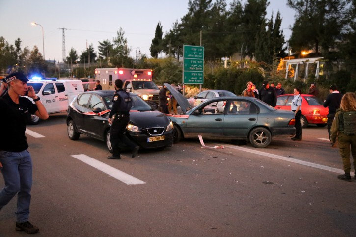 Israeli security forces and rescue personnel at the scene of a drive-by shooting near the West Bank settlement of Alon Shvut, in the Etzion Bloc, on November 19, 2015. Three people were killed in the terrorist attack, and several more wounded. Photo by Gershon Elinson/FLASH90