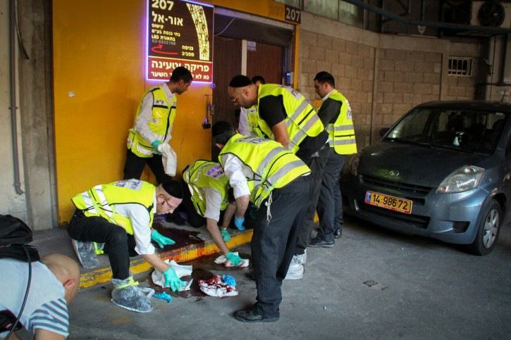 ZAKA personnel at the scene of where two Israelis were killed and at least two others wounded in a stabbing attack in southern Tel Aviv , on November 19, 2015.