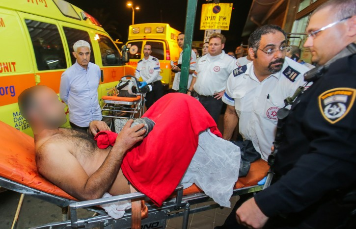 Medical personnel rush an Israeli man to the emergency unit at Barzilai Hospital in Ashkelon after he was wounded in a stabbing attack in the southern Israeli city of Kiryat Gat, on November 21, 2015. Four Israelis were stabbed in the terror attack. Photo by Edi Israel/Flash90
