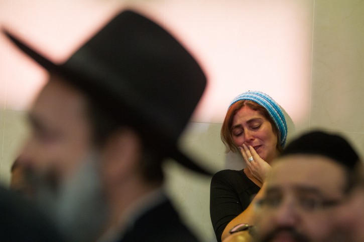 Mourners react during the funeral of Hadar Buchris, 21, in Jerusalem on November 23, 2015. Hadar Buchris was murdered in a stabbing attack at the West Bank's Gush Etzion Junction yesterday. Photo by Mirian Alster/Flash90