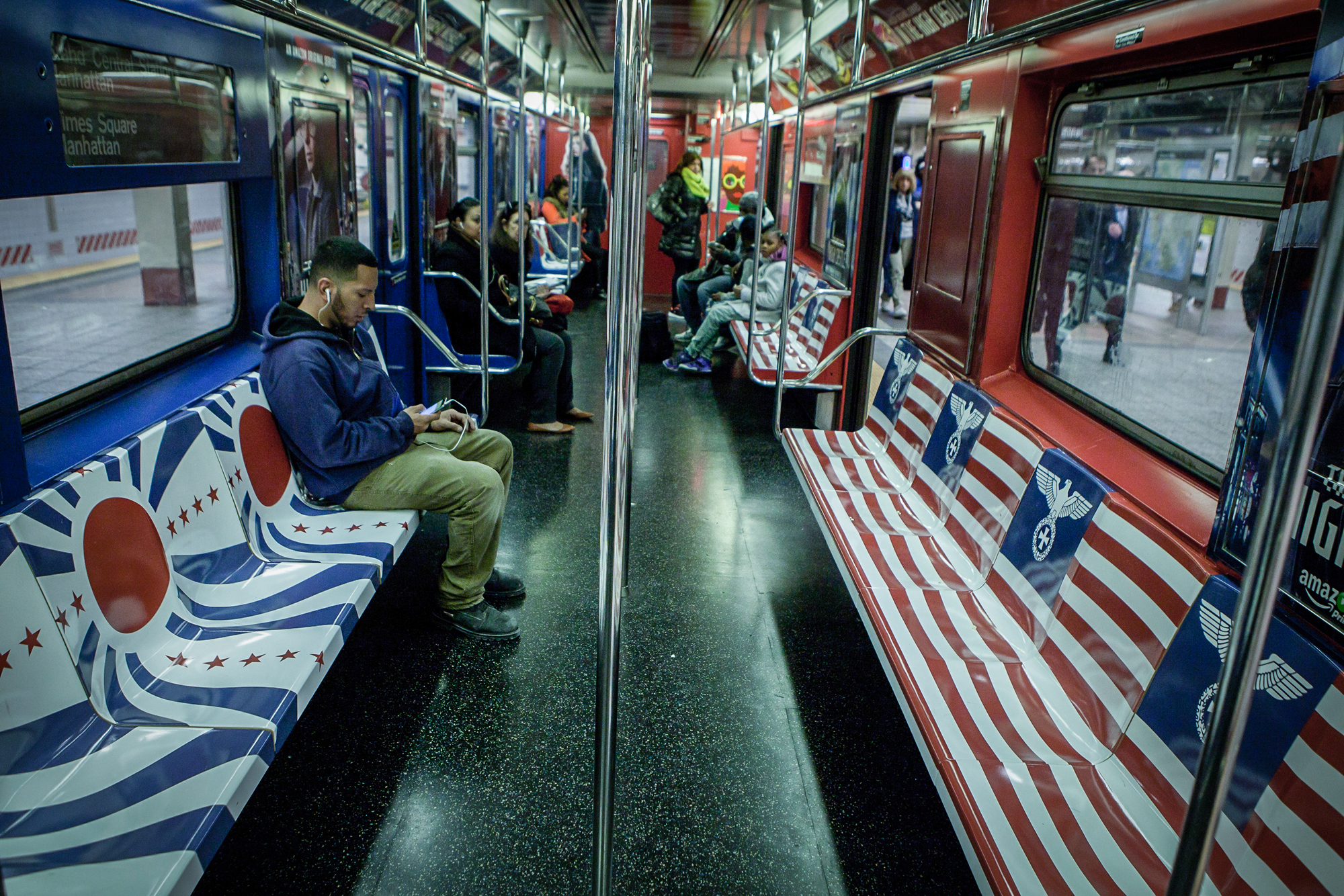 Baltimorejewishlife amazon promotion covers nyc subway in a passenger sits on a bench that is covered with nazi germany and imperial japan symbols biocorpaavc Gallery
