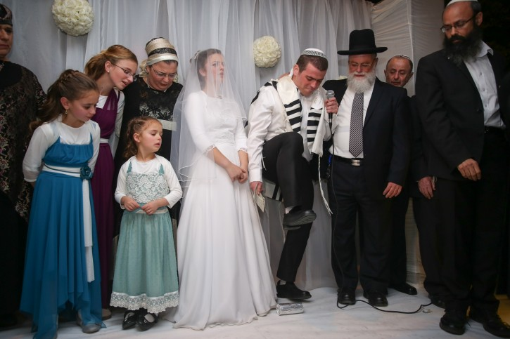 Friends and family attend the wedding of Sarah Litman and Ariel Beigel at the Jerusalem International Convention Center, November 26, 2015. Father and brother of Sarah Litman where murdered by an Arab terrorists on November 14, 2015, as they made their way to the pre-wedding Shabbat Chatan celebration. Photo by Hadas Parush/Flash90