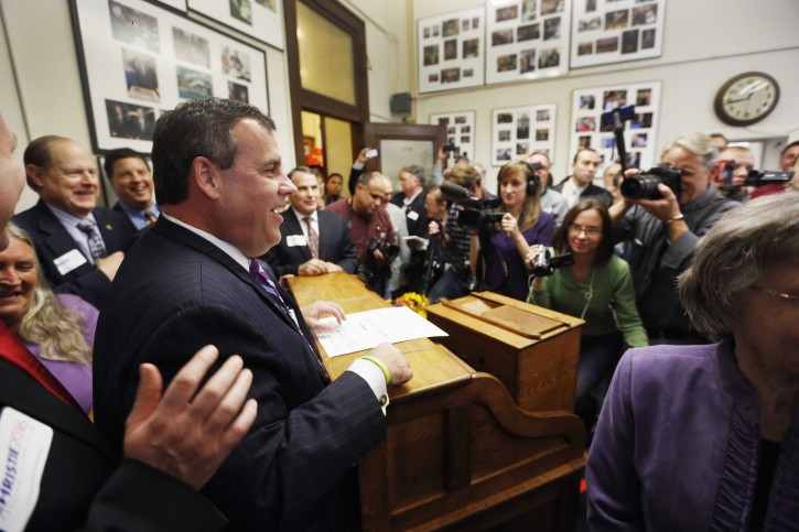 Republican presidential candidate, New Jersey  Gov. Chris Christie smiles after filing papers to be on the nation's earliest presidential primary ballot, Friday, Nov. 6, 2015, at The Secretary of State's office in Concord, N.H. (AP Photo/Jim Cole)