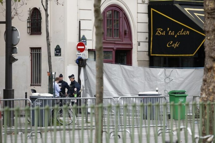 Police secure the area near the screened-off facade of the Bataclan Cafe and its adjoining concert hall the day after a series of deadly attacks in Paris, France, November 14, 2014. REUTERS/Benoit Tessier