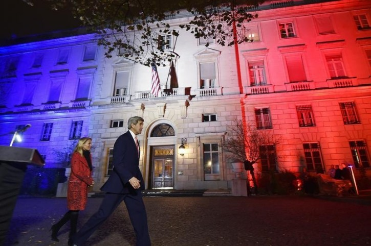 FILE - US Secretary of State John Kerry (C), next to US ambassador to France Jane D. Hartley, leaves after delivering a speech at the US embassy illuminated with the colors of the French national flag on November 16, 2015 in Paris. REUTERS/Dominique Faget/Pool