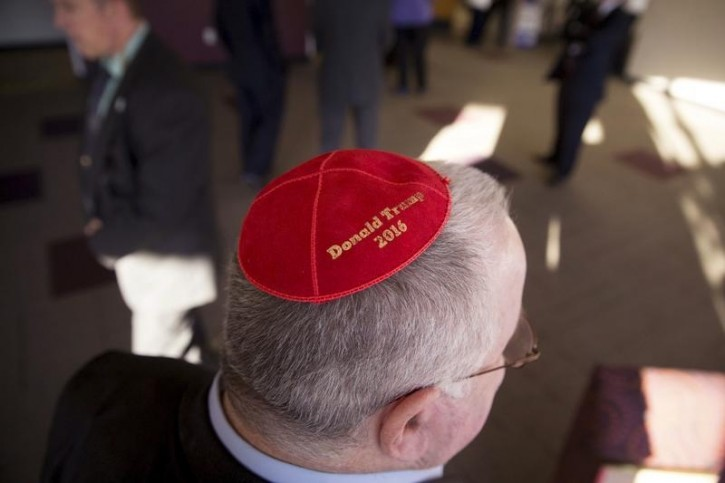 Marc Daniels of Springfield, a supporter of U.S. Republican presidential candidate Donald Trump, wears a custom yarmulke supporting Trump at a campaign Town Hall forum in Newton, Iowa, November 19, 2015. REUTERS/Scott Morgan