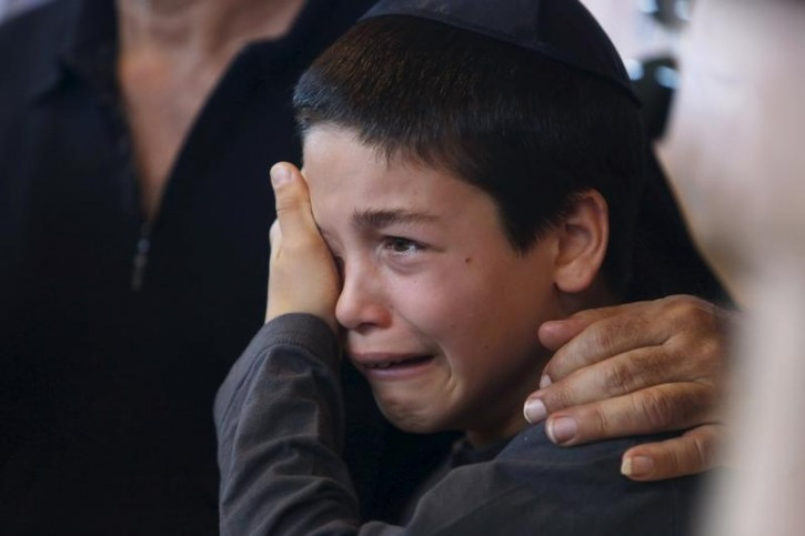 A nephew of Reuven Aviram, 51, mourns during his uncle's funeral in Ramle, Israel November 20, 2015. Aviram was one of two people killed yesterday in a Palestinian stabbing attack in Tel Aviv. REUTERS/Nir Elias