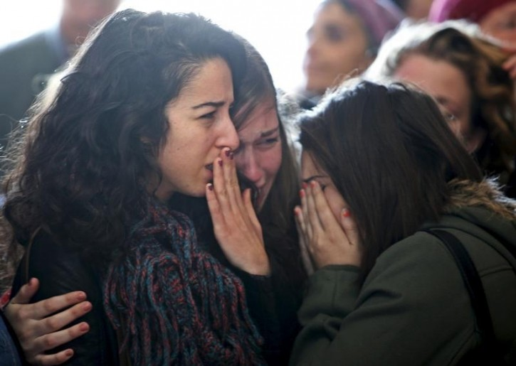 Mourners react during the funeral for Israeli Hadar Buchris, 21, in Jerusalem, November 23, 2015. Reuters