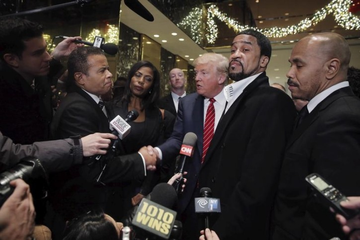 Presidential candidate Donald Trump (C)  speaks to the media after meeting with a group of black pastors at his office in the Manhattan borough of New York November 30, 2015. REUTERS/Lucas Jackson