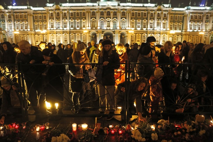 People gathered to light candles during a day of national mourning for the plane crash victims at Dvortsovaya (Palace) Square in St. Petersburg, Russia, on Sunday, Nov. 1, 2015.  The Metrojet charter crashed Saturday morning 23 minutes after taking off from Egypt's Red Sea resort of Sharm el-Sheikh, a top destination for Russian tourists. All 224 people on board died.  (AP Photo/Dmitry Lovetsky)