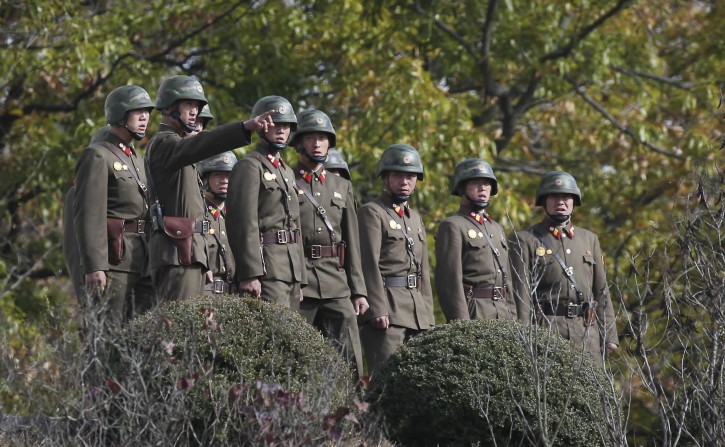 North Korean army solider look southern side as U.S. Defense Secretary Ash Carter visits at the border village of Panmunjom, which has separated the two Koreas since the Korean War, in Paju, South Korea, Sunday, Nov. 1, 2015. Carter is visiting the buffer zone separating North and South Korea to highlight the American commitment to defend its South Korean ally.(Korea Pool Photo via AP)