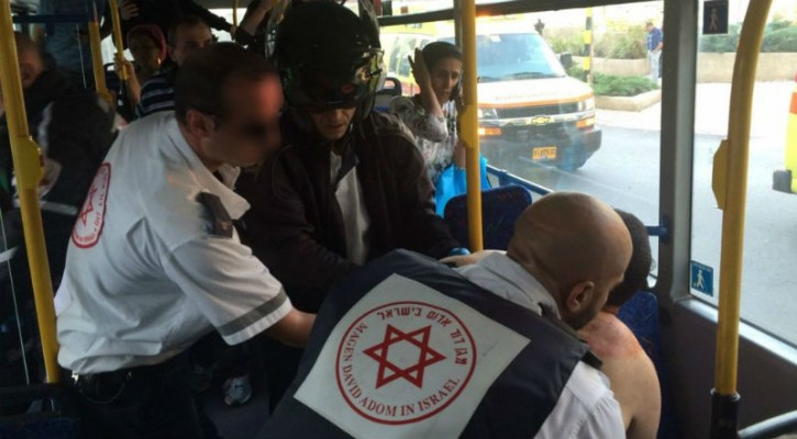 Magen David Adom medics treat an Israeli man, later identified as Daniel Cohen, 31, from Bnei Brak, on a bus in Rishon Lezion shortly after he was stabbed by a Palestinian from Hebron, November 2, 2015. (Eliran Avital/MDA)