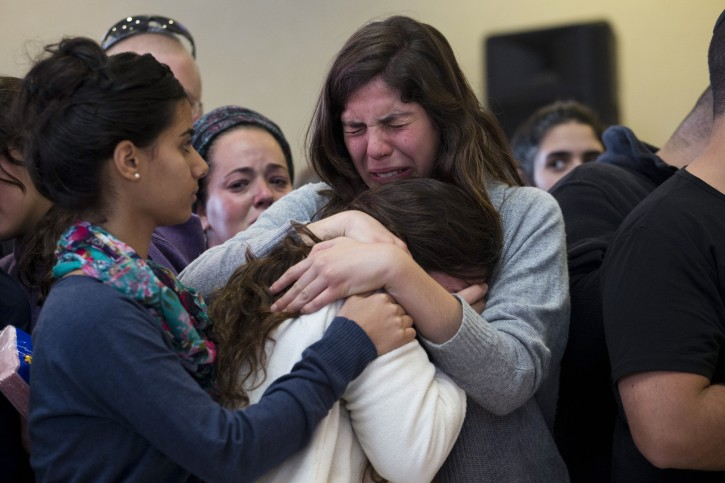 Family members and relatives of Israeli Hadar Buchris mourn during her funeral ceremony in Jerusalem, Israel, 23 November 2015. Hadar Buchris, 21, was killed by a Palestinian attacker who stabbed her to death at the central bus station in the Gush Etzion settlement block junction in the West Bank on 22 November.  EPA/ABIR SULTAN