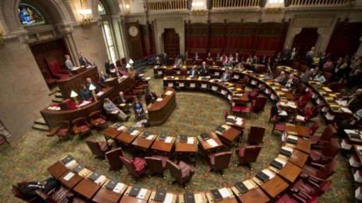 FILE - Chairs are empty on the Democratic side of the Senate Chamber after Democratic senators walked out of session at the Capitol on Wednesday, May 6, 2015, in Albany, N.Y. AP Photo/Mike Groll)