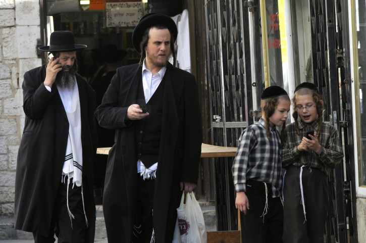 Ultra orthodox Jews on the phone in Mea shearim in Jerusalem photo by Serge Attal / FLASH90