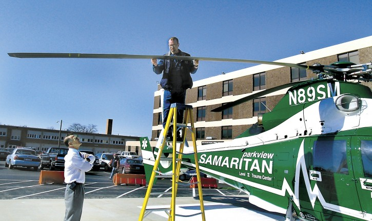 In this Wednesday, April 14, 2004, file photo, Parkview Samaritan helicopter pilot Brad Wilson checks the rotor blade for damage after being struck by a bird while flying, just one mile from Community Hospitals of Williams County, in Bryan, Ohio, the destination landing pad to transport a patient.  (Carla Allshouse/The Bryan Times via AP, File)