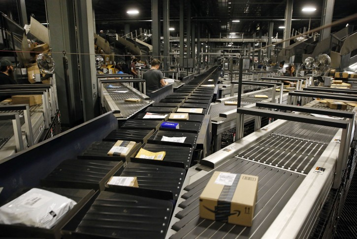 In this Nov. 20, 2015 photo, parcels make their way along some of Worldport's 155 miles of conveyor belts in Louisville, Ky. If everything goes right, the packages are just touched twice by humans: first when pulled out of large aircraft shipping containers and then again at the end of their journey through the conveyors and into a new bin and another jet. (AP Photo/Patrick Semansky)