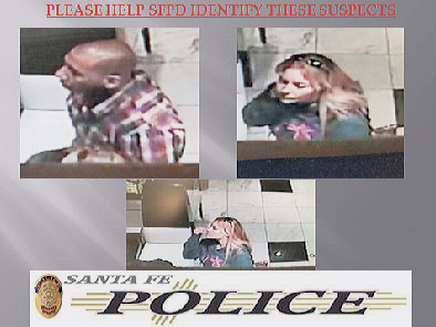 This video frame grab from a surveillance camera provided by the Santa Fe, New Mexico Police department shows suspects in a heist at Diva Diamonds & Jewels in Santa Fe, N.M.  Police say thieving hands reached into an unlocked glass jewelry case while staff were too busy attending to customers to notice on Friday, Nov. 27, 2015.  (Courtesy of Santa Fe, New Mexico Police department via AP)