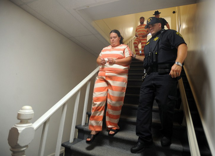 FILE - In this Aug. 15, 2014, file photo, deputies from the St. Lawrence County Sheriff's Department escort Nicole Vaisey, left, and Stephen Howells, to their arraignment on first-degree kidnapping charges at Fowler Town Court in Fowler, N.Y. The couple who kidnapped two Amish girls from a farmstand in northern New York and sexually exploited them and other children face sentencing in federal court on Thursday, Dec. 17, 2015. (Melanie Kimbler-Lago/The Watertown Daily Times via AP, File)