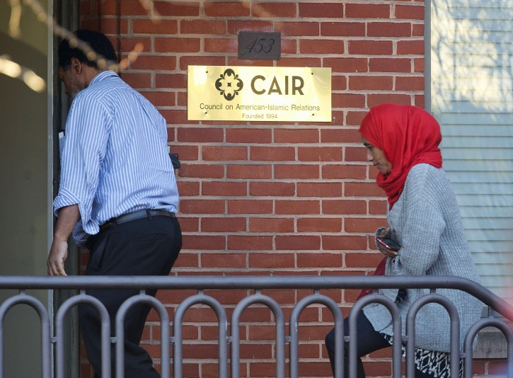 People return to the headquarter of Council on American-Islamic Relations (CAIR) in Washington, Thursday, Dec. 10, 2015, after getting the go ahead from emergency personal. Earlier the building was evacuated after staffers came in contact with a suspicious substance that arrived in the mail. (AP Photo/Pablo Martinez Monsivais)