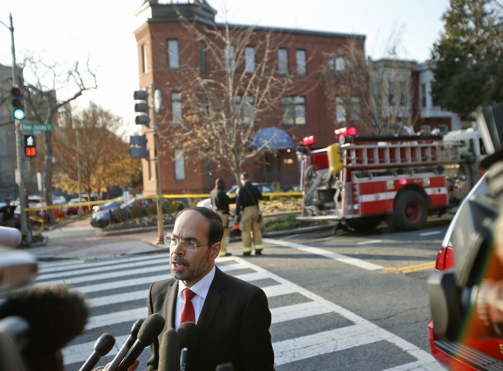 Council on American-Islamic Relations (CAIR) Executive Director and co-founder Nihad Awad speaks to members of the media as firefighters are seen in the background at CAIR headquarters on Capitol Hill in Washington, Thursday, Dec. 10, 2015, after the building was evacuated. A spokesman for a Muslim group said its headquarters on Capitol Hill have been evacuated after staffers came in contact with a suspicious substance that arrived in the mail. (AP Photo/Pablo Martinez Monsivais)